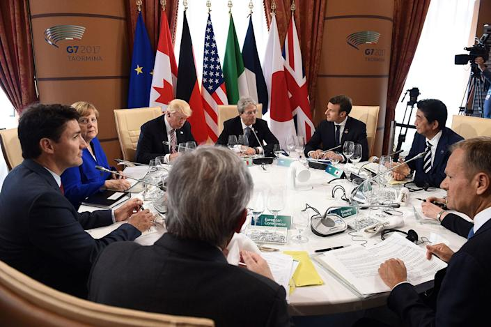 <p>G7 Summit members attend the first working session, with from bottom C, President of the European Commission President Jean-Claude Juncker, Canadian Prime Minister Justin Trudeau, German Chancellor Angela Merkel, U.S. President Donald Trump, Italian Prime Minister Paolo Gentiloni, President of France Emmanuel Macron, Japan's Prime Minister Shinzo Abe, Britain's Prime Minister Theresa May (hidden) and President of the European Council Donald Tusk, in Taormina in Sicily, Italy, May 26, 2017. (Photo: Eliot Blondet/Pool/Reuters) </p>