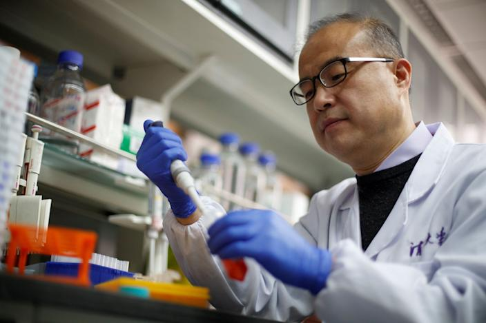 FILE PHOTO: Scientist Linqi Zhang demonstrates work in his laboratory where he researches novel coronavirus disease (COVID-19) antibodies for possible use in a drug at Tsinghua University's Research Center for Public Health in Beijing, China, March 30, 2020. REUTERS/Thomas Peter