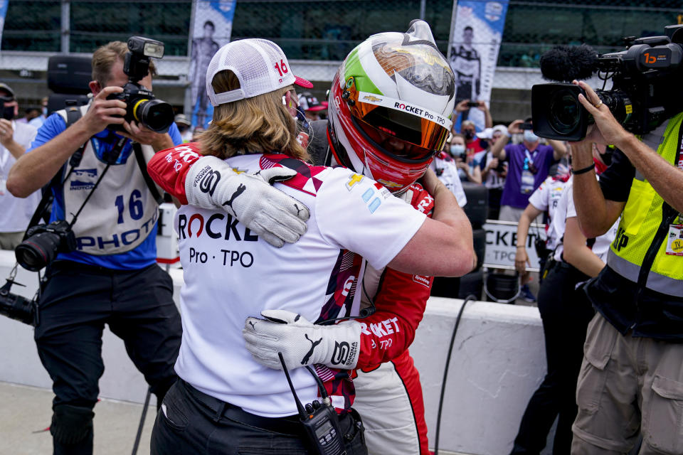 Simona De Silvestro of Switzerland hugs a member of her crew after making the field during the last row qualifications for the Indianapolis 500 auto race at Indianapolis Motor Speedway in Indianapolis, Sunday, May 23, 2021. (AP Photo/Michael Conroy)