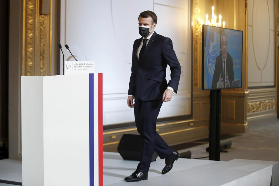 French President Emmanuel Macron arrives a video-conference meeting ahead of 2021 Munich Security Conference at the Elysee palace in Paris, Friday Feb. 19, 2021. (Benoit Tessier/Pool via AP)