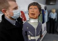 Alastair McCrea of Ewbank's Auctioneers, prepares a Battlehawk model from Gerry Anderson and Christopher Burr's Terrahawks at their showroom, ahead of a sale in Woking