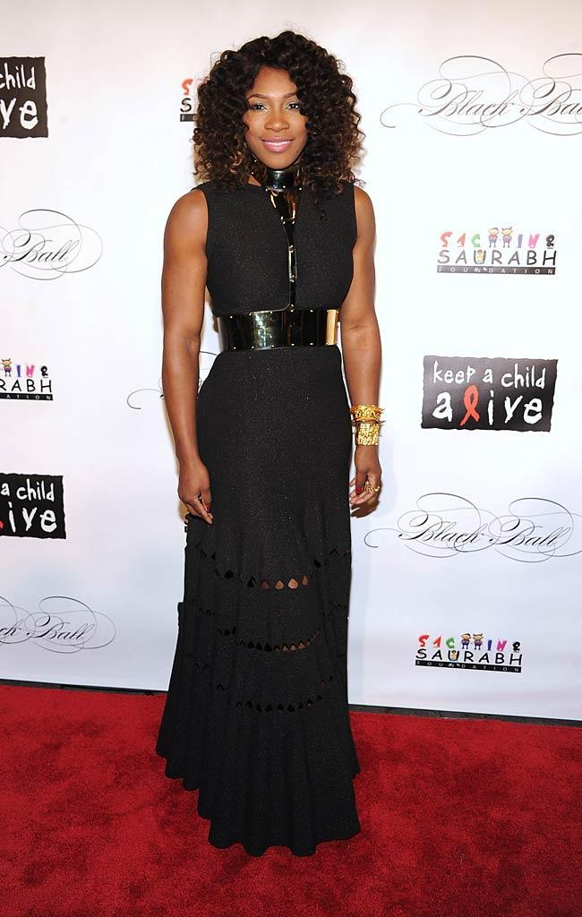 Serena Williams appeared quite fierce in a black floor-length gown -- which accentuated her muscular arms -- at the Keep a Child Alive annual Black Ball benefit. Unfortunately, the tennis ace accessorized with a metal belt/collar combination, which made her look as if she could barely breathe. (11/3/2011)