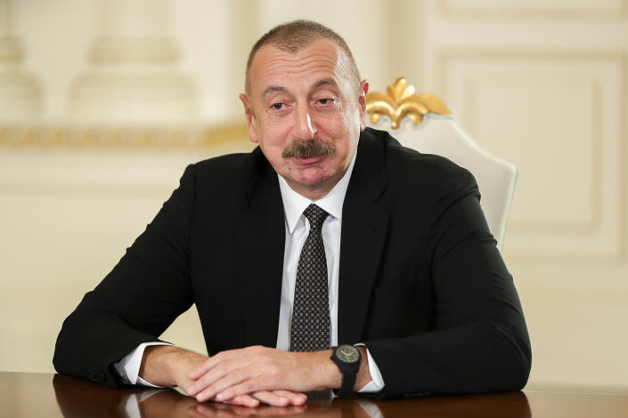 FILE - In this May 10, 2021, file photo released by Russian Foreign Ministry Press Service, Azerbaijani President Ilham Aliyev speaks to Russian Foreign Minister Sergey Lavrov during their meeting in Baku, Azerbaijan. Hundreds of world leaders, powerful politicians, billionaires, celebrities, religious leaders and drug dealers have been stashing away their investments in mansions, exclusive beachfront property, yachts and other assets for the past quarter century, according to a review of nearly 12 million files obtained from 14 different firms located around the world. The report released Sunday, Oct. 3, 2021 by the International Consortium of Investigative Journalists involved 600 journalists from 150 media outlets in 117 countries. Azerbaijani President Ilham Aliyev is one of 330 current and former politicians identified as beneficiaries of the secret accounts. (Russian Foreign Ministry Press Service via AP, File)