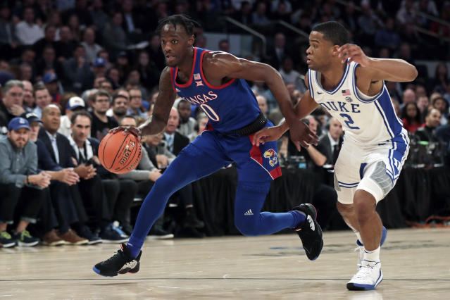 """Kansas guard Marcus Garrett (0) drives to the basket past Duke guard <a class=""""link rapid-noclick-resp"""" href=""""/ncaab/players/152781/"""" data-ylk=""""slk:Cassius Stanley"""">Cassius Stanley</a> (2) during the first half of an NCAA college basketball game Tuesday, Nov. 5, 2019, in New York. (AP Photo/Adam Hunger)"""
