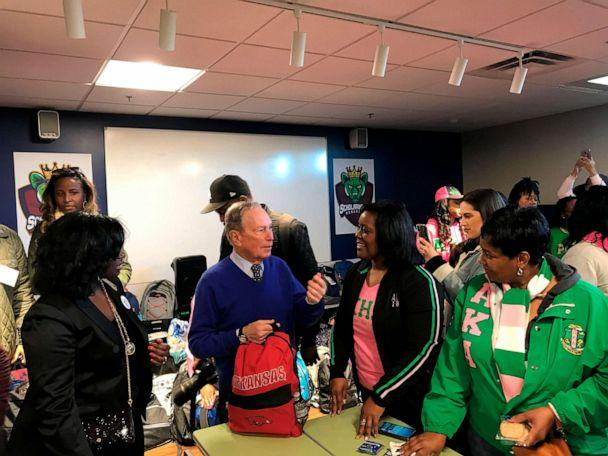 PHOTO: Former New York City Mayor and presidential hopeful Michael Bloomberg talks to volunteers assembling backpacks at Scholarmade Achievement Place in Little Rock, Ark., Jan. 20, 2020. (Andrew Demillo/AP)