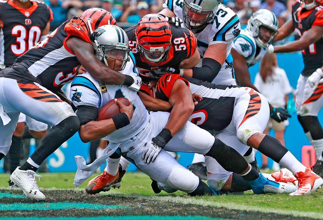<p>Carolina Panthers' Cam Newton (1) poses over the goal line for a touchdown against the Cincinnati Bengals during the second half of an NFL football game in Charlotte, N.C., Sunday, Sept. 23, 2018. (AP Photo/Jason E. Miczek) </p>