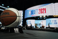 Stage crews prepare for the start of the NBA basketball draft, Monday, July 19, 2021, in New York. (AP Photo/Corey Sipkin)