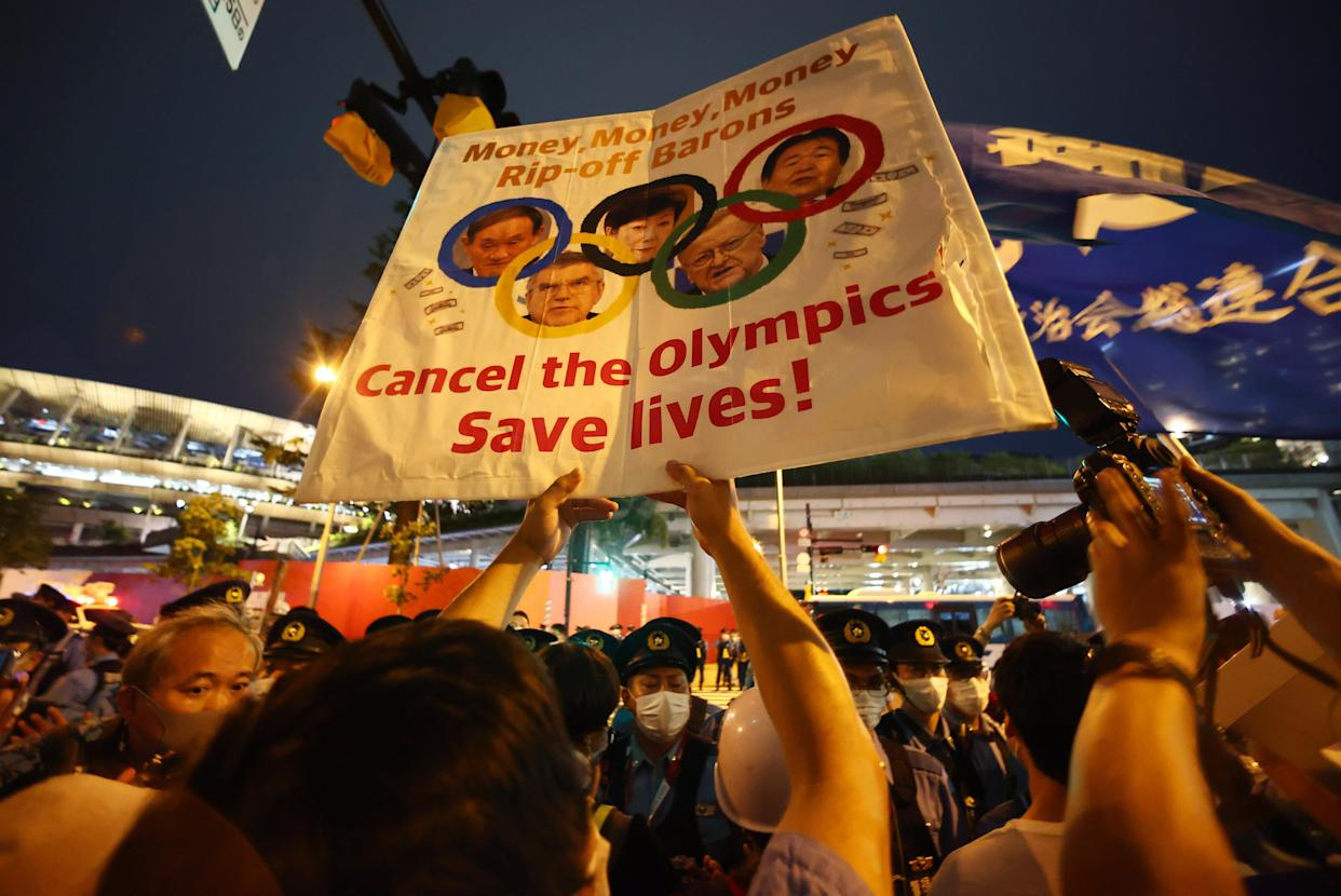 Anti-Olympics protesters gather outside the stadium. (Reuters)