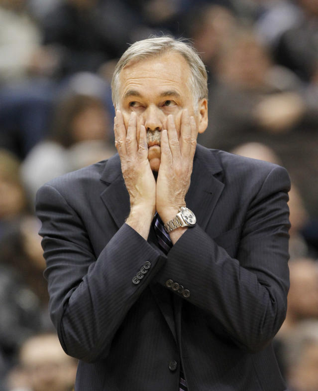 Los Angeles Lakers head coach Mike D'Antoni disagrees with a call during the first quarter of an NBA basketball game against the Minnesota Timberwolves in Minneapolis, Friday, March 28, 2014. The Timberwolves won 143-107. (AP Photo/Ann Heisenfelt)