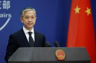 FILE PHOTO: Chinese Foreign Ministry spokesman Wang Wenbin speaks during a news conference in Beijing