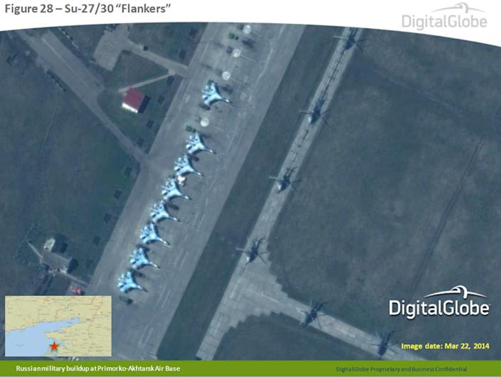 """This satellite image made by DigitalGlobe on March 22, 2014, and provided by Supreme Headquarters Allied Powers Europe (SHAPE) on Tuesday, April 9, 2014, shows what are purported to be Russian military Su-27/30 """"Flankers"""" aircraft at the Primorko-Akhtarsk Air Base in southern Russia. The image is one of several provided to the AP by NATO's headquarters that show dozens of Russian tanks and other armored vehicles, combat jets and helicopter gunships stationed inside Russian territory near to the eastern border with Ukraine. AP cannot independently verify the authenticity or content of this image. (AP Photo/DigitalGlobe via SHAPE) MANDATORY CREDIT, NO CROPPING OR MODIFICATIONS ALLOWED"""
