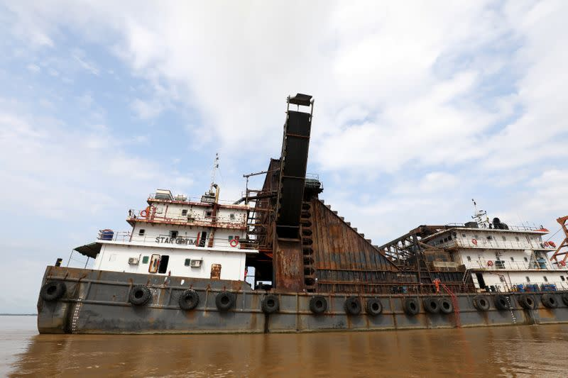 Star Optimus, a hopper dredger vessel that belongs to Starhigh Asia Pacific, sits docked on the Salween river in Mawlamyine