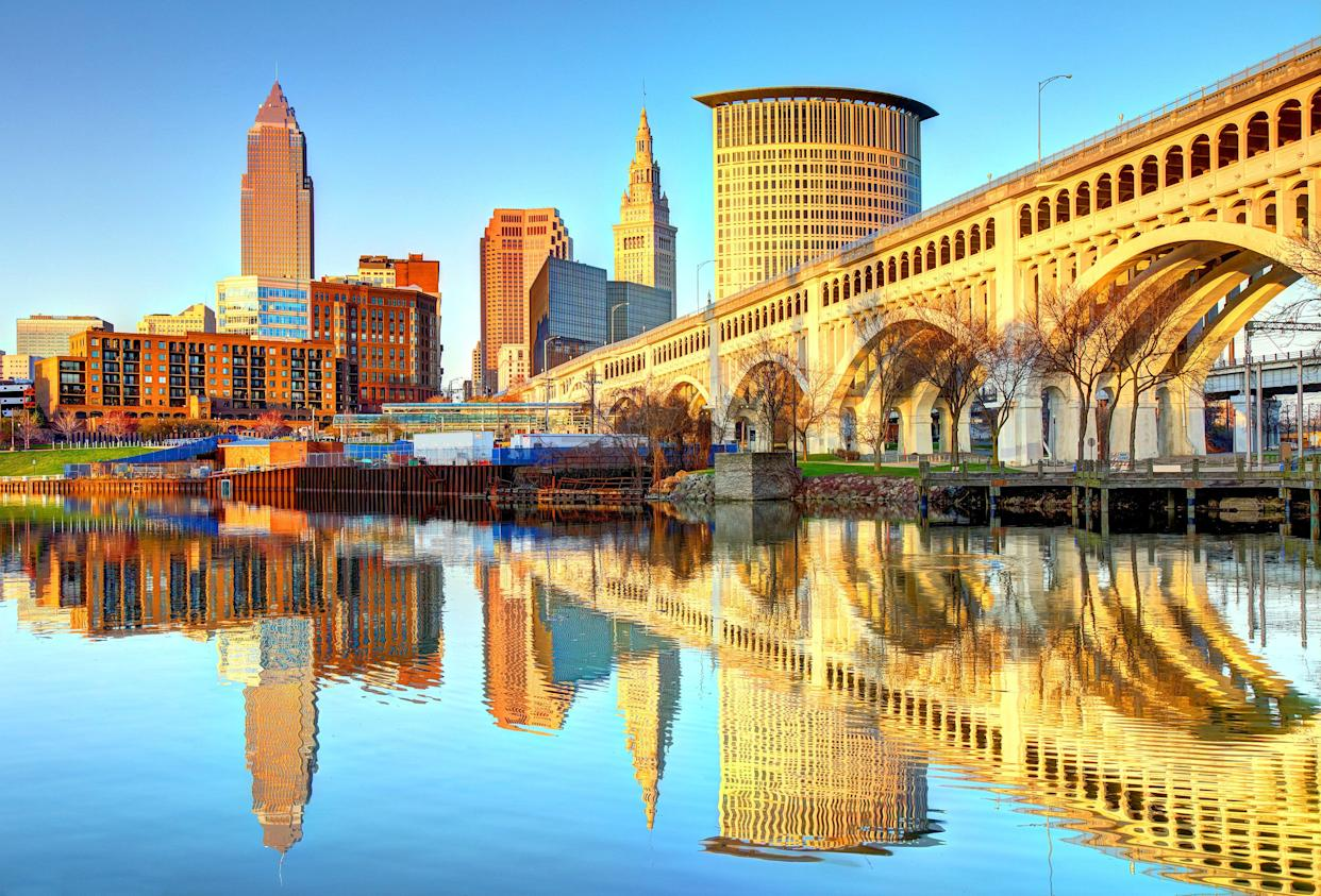 The Cleveland skyline is reflected on the Cuyahoga River, 2018. (Photo: Getty images)