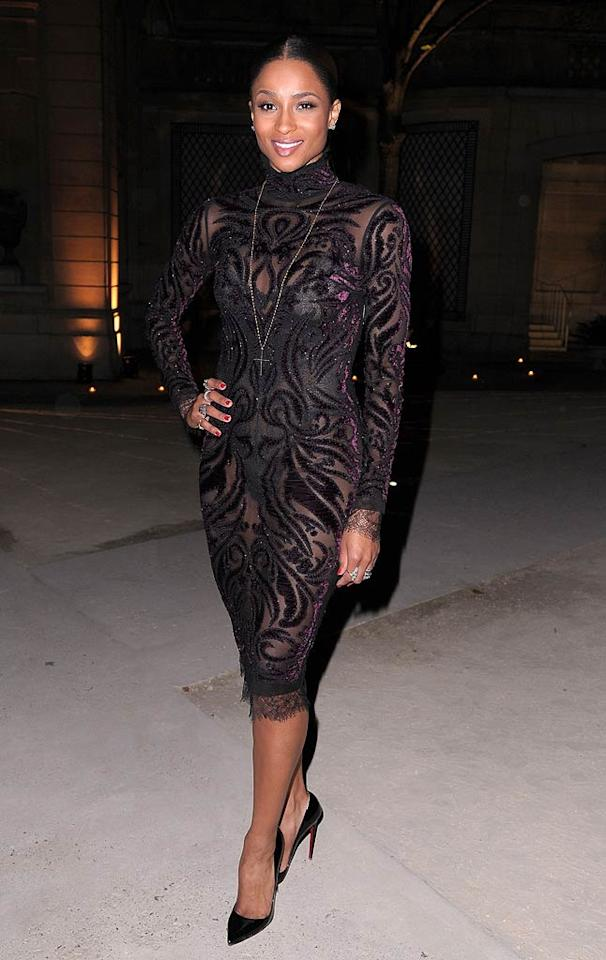 """Call me crazy, but I think """"1, 2 Step"""" songstress Ciara's black bodysuit would have looked a whole lot better had it not been suffocated by her showgirl-esque Emilio Pucci ensemble.  Dominique Charriau/WireImage.com - September 30, 2011"""