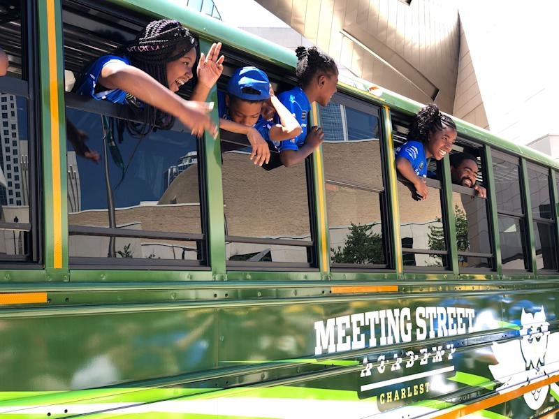 Students at Meeting Street Academy were excited to check out their beautiful new bus that was donated by Credit One Bank and the NASCAR Foundation
