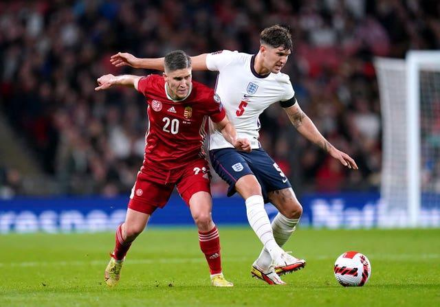 Goalscorers John Stones, right, and Roland Sallai battle for the ball