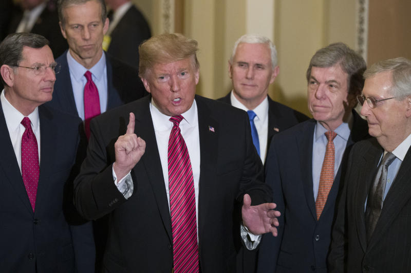 Sen. John Barrasso, R-Wyo., left, and Sen. John Thune, R-S.D., stand with President Donald Trump, Vice President Mike Pence, Sen. Roy Blunt, R-Mo., and Senate Majority Leader Mitch McConnell of Ky., as Trump speaks while departing after a Senate Republican Policy luncheon, on Capitol Hill in Washington, Wednesday, Jan. 9, 2019. (AP Photo/Alex Brandon)