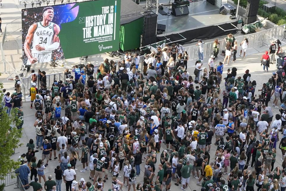 Fans gather outside the Fiserv Forum to watch Game 1 of the NBA Eastern Conference basketball finals game between the Milwaukee Bucks and the Atlanta Hawks Wednesday, June 23, 2021, in Milwaukee. (AP Photo/Morry Gash)