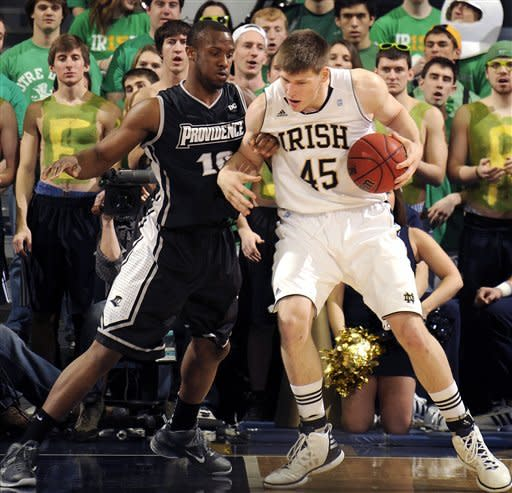 Notre Dame forward Jack Cooley, right, drives against Providence forward Kadeem Bates during the first half of an NCAA college basketball game Friday March 2, 2012, in South Bend, Ind. (AP Photo/Joe Raymond)