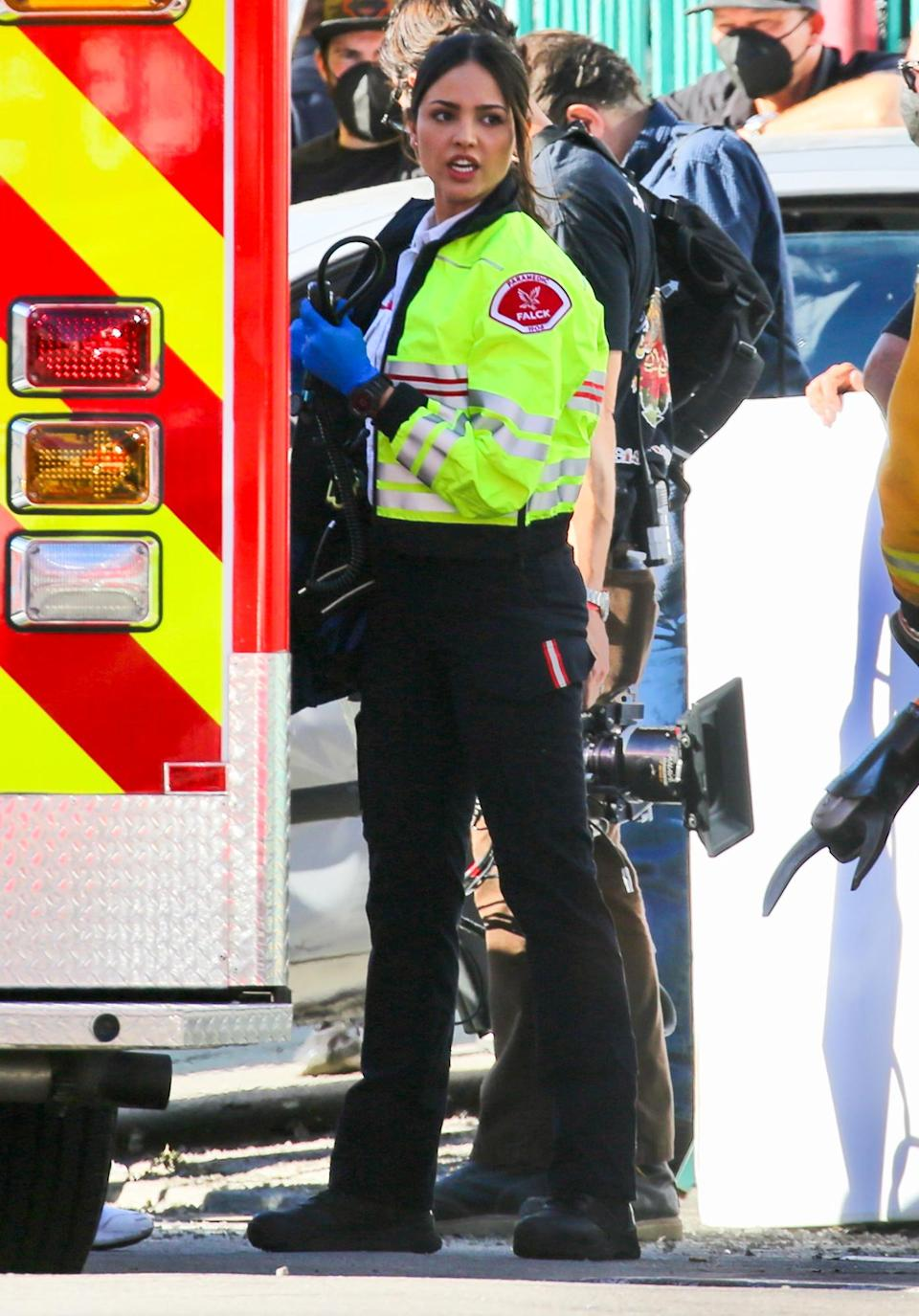 <p>Eiza Gonzalez springs into action as she responds to a car crash on the set of <em>Ambulance</em> in Los Angeles on Monday.</p>