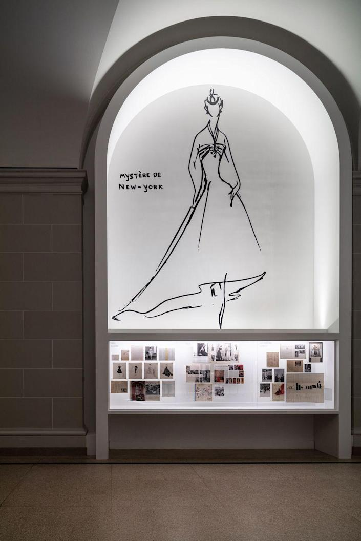 <p>Dior sketches and images on display at the exhibition's entrance. </p>