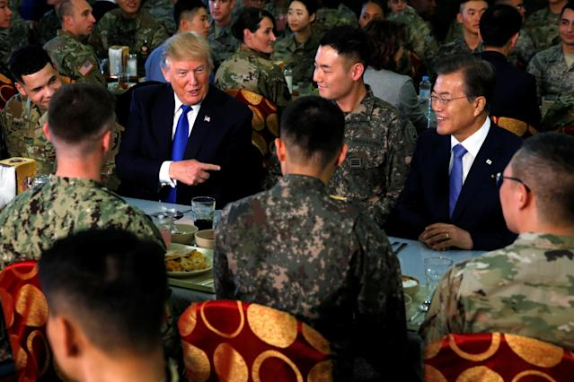 <p>President Donald Trump and South Korea's President Moon Jae-in have lunch with troops at U.S. military installation Camp Humphreys in Pyeongtaek, South Korea, Nov. 7, 2017. (Photo: Jonathan Ernst/Reuters) </p>