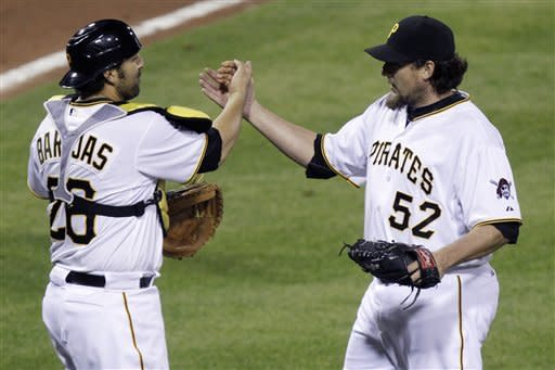 Pittsburgh Pirates closer Joel Hanrahan (52) celebrates with catcher Rod Barajas after getting the final out of a 4-2 win over the Washington Nationals in a baseball game in Pittsburgh on Wednesday, May 9, 2012. (AP Photo/Gene J. Puskar)