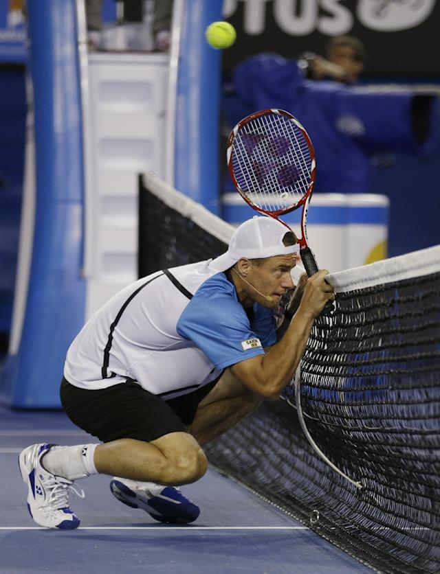 Australia's Lleyton Hewitt ducks as a ball passes above him during an exhibition match on Kids Tennis Day ahead of the Australian Open tennis championship in Melbourne, Australia, Saturday, Jan.11, 2014. (AP Photo/Aijaz Rahi)