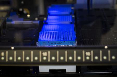 FILE PHOTO:  A robotic DNA sample automation machine works on DNA samples at a Regeneron Pharmaceuticals Inc. laboratory at the biotechnology company's headquarters in Tarrytown