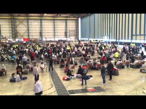 Hundreds Wait in Brussels Airport Hangar Following Blasts