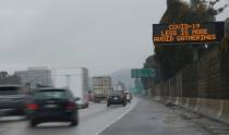 FILE PHOTO: A highway sign usually used for traffic reports advises drivers to practice social distancing due to the global outbreak of coronavirus (COVID-19) in Pasadena