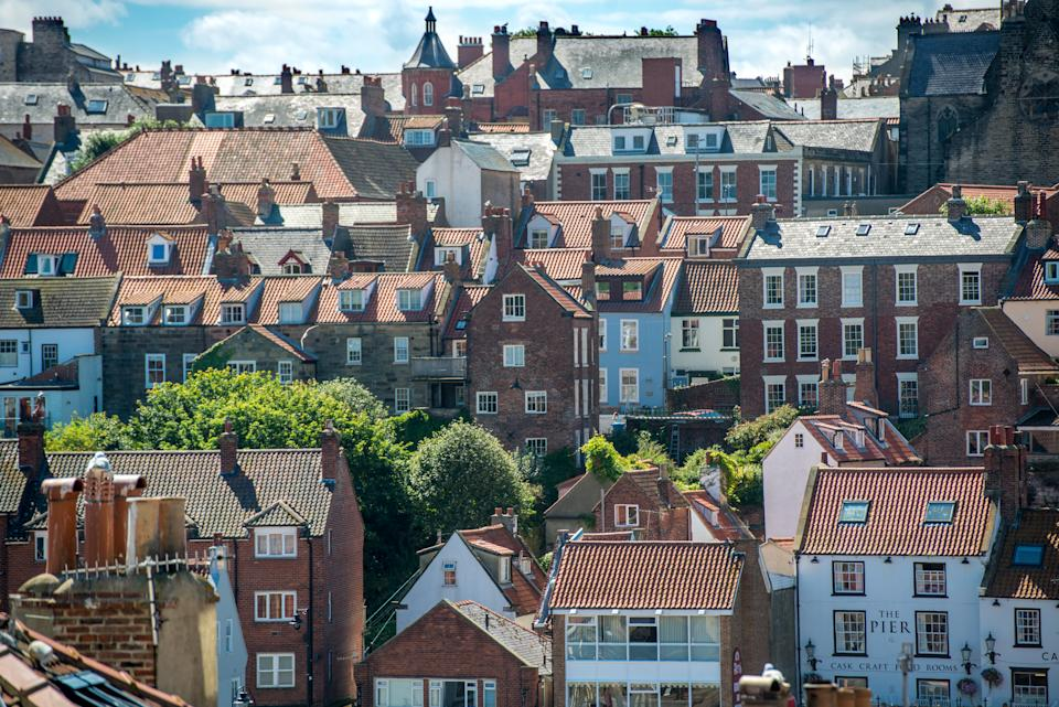 City scape of tightly arranged row houses, Whitby, Yorkshire, UK