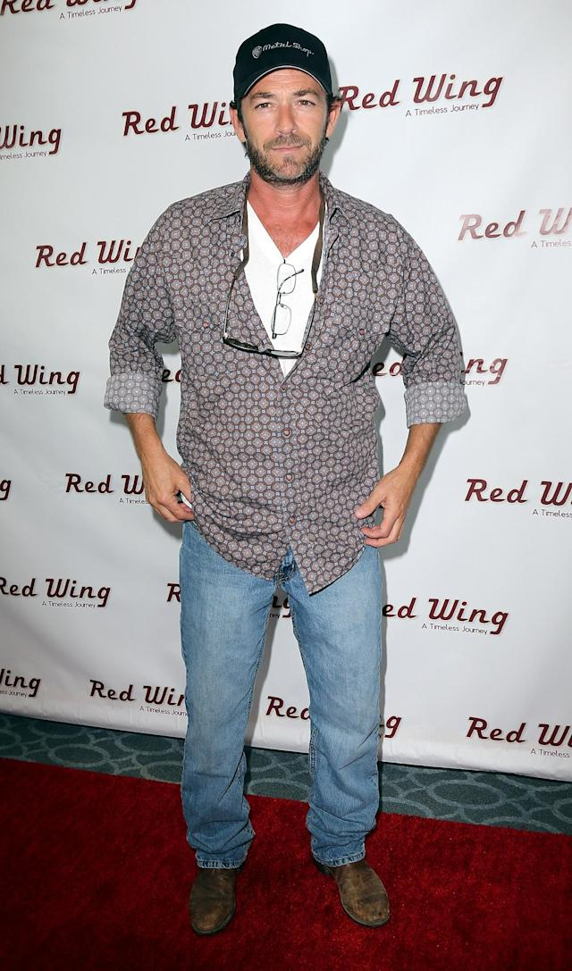 """LOS ANGELES, CA - AUGUST 06: Actor Luke Perry attends a screening of Integrity Film Production's """"Red Wing"""" at Harmony Gold Theatre on August 6, 2013 in Los Angeles, California. (Photo by David Livingston/Getty Images)"""