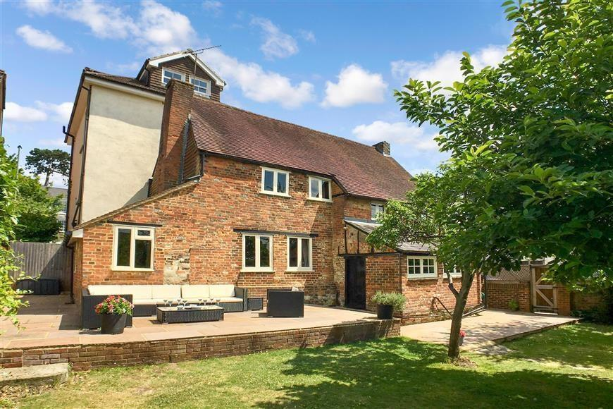 £595,000: a four-bedroom cottage with inglenook fireplace through Cubitt & West, 01737 904 132 (Rightmove)