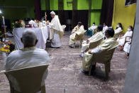 In this photo provided by the Rev. Cedric Prakash, the Rev. Jerry Sequeira, standing, preaches at St. Ignatius Loyola church in Ahmedabad, India, shortly before contracting and dying from the coronavirus in April 2021. Sequeira was one of more than 500 Catholic priests and nuns who have died from COVID-19 in India, according to the Rev. Suresh Mathew, a priest at Holy Redeemer's Church in New Delhi and the editor of the church-run Indian Currents magazine. (Cedric Prakash via AP)