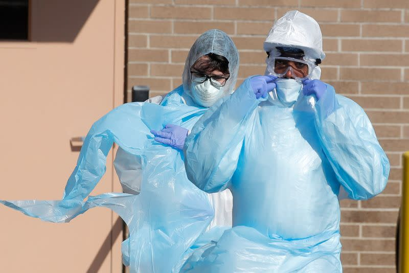 Healthcare workers in PPE outside Wyckoff Heights Medical Center during outbreak of coronavirus disease (COVID-19) in New York