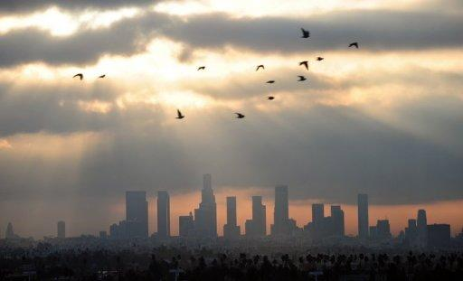 Birds fly across the sky at daybreak over the downtown Los Angeles skyline on December 14, 2011. The 21st century's first decade was the hottest on record, with temperatures rising at an unprecedented pace and weather extremes claiming over 370,000 lives, the United Nations said Wednesday