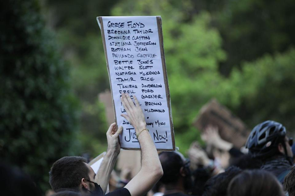 <p>A sign simply lists a few of the many, many BIPOC who have been killed unjustly. </p>