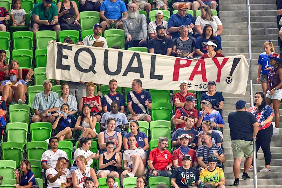 AUSTIN, TX - JUNE 16: United States fans hold up an Equal Pay banner in protest of unequal wages for female athletes in action during a Summer Series friendly international match between Nigeria and the United States on June 16, 2021 at Q2 Stadium in Austin, TX. (Photo by Robin Alam/Icon Sportswire via Getty Images)