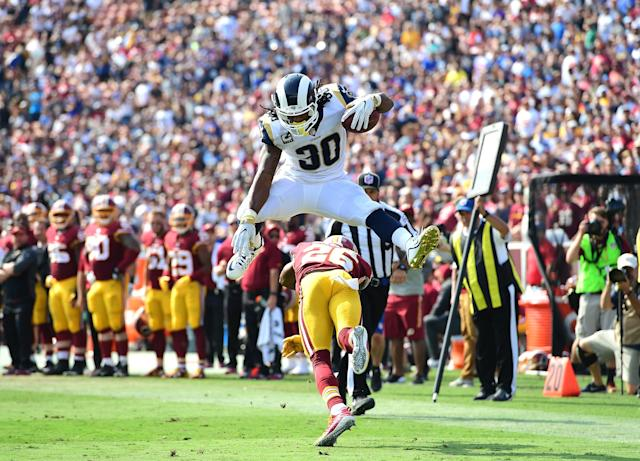 Todd Gurley leaps over Bashaud Breeland of the Washington Redskins before scoring a touchdown during the third quarter at Los Angeles Memorial Coliseum (Getty Images)