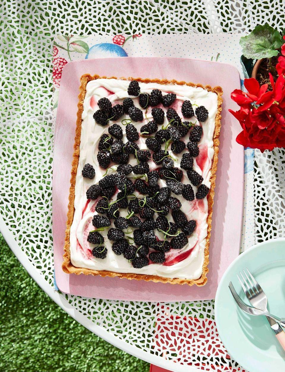 """<p>Fresh blackberries and coconut make for a delicious, not-too-sweet dessert perfect for springtime.</p><p><strong><a href=""""https://www.countryliving.com/food-drinks/a32352700/blackberry-coconut-tart/"""" rel=""""nofollow noopener"""" target=""""_blank"""" data-ylk=""""slk:Get the recipe"""" class=""""link rapid-noclick-resp"""">Get the recipe</a>.</strong></p>"""
