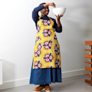 "<p><strong>Kemi Telford</strong></p><p>kemitelford.com</p><p><strong>£25.00</strong></p><p><a href=""https://kemitelford.com/collections/christmas-gift-ideas/products/sunshine-flower-apron"" rel=""nofollow noopener"" target=""_blank"" data-ylk=""slk:Shop Now"" class=""link rapid-noclick-resp"">Shop Now</a></p><p>Kemi Telford's apron is a great gift for the mom who loves to bake. The bold floral print will brighten up any kitchen. </p>"