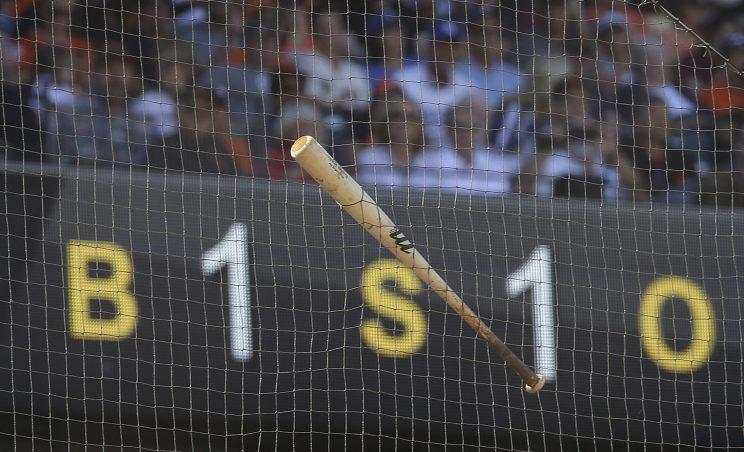 A bat that slipped out of the hands of San Francisco Giants' Buster Posey hangs from the netting behind home plate in the second inning of a baseball game against the Los Angeles Dodgers, Saturday, June 11, 2016, in San Francisco. (AP Photo/Ben Margot)