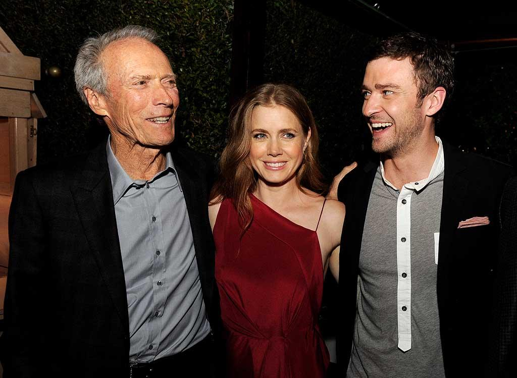"With no empty chair to talk to, Clint Eastwood chatted instead with his co-stars Amy Adams and Justin Timberlake at the afterparty for the premiere of their new film ""Trouble With the Curve"" in Los Angeles on Tuesday. (9/18/2012)"