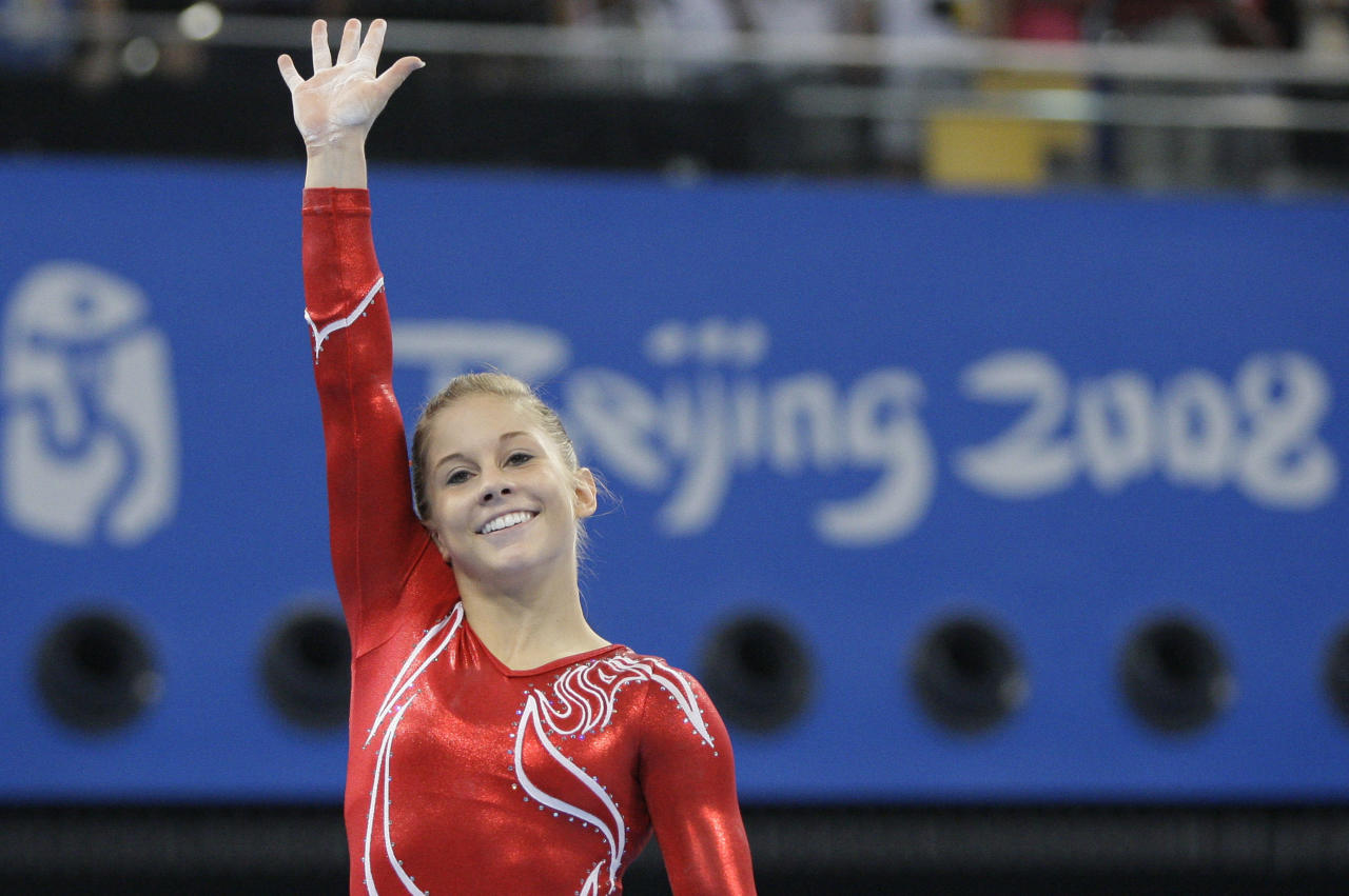 U.S. gymnast Shawn Johnson waves to the crowd during the women's team final competition at the Beijing 2008 Olympics  in Beijing, Wednesday, Aug  13, 2008. (AP Photo/Amy Sancetta)
