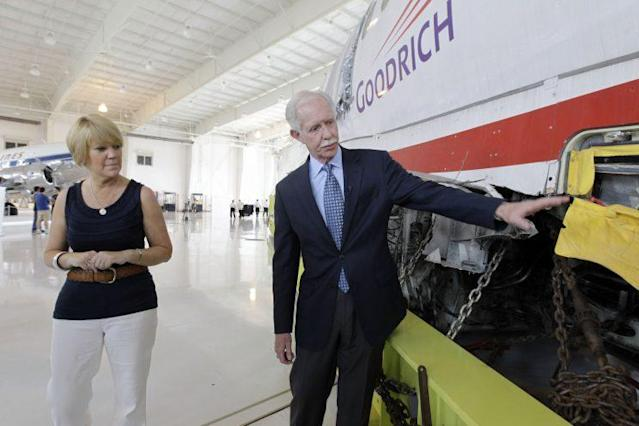 "Former Capt. Chesley ""Sully"" Sullenberger, right, talks with passenger Pam Seagle as they look over the fuselage of US Airways Flight 1549 at the Carolinas Aviation Museum, Saturday, June 11, 2011, in Charlotte, N.C. (Photo: Chuck Burton/AP)"
