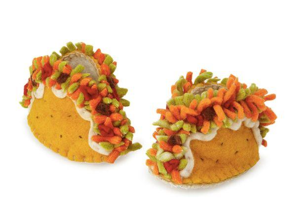 """<a href=""""https://www.uncommongoods.com/product/taco-booties"""" target=""""_blank"""">Shop them here</a>."""