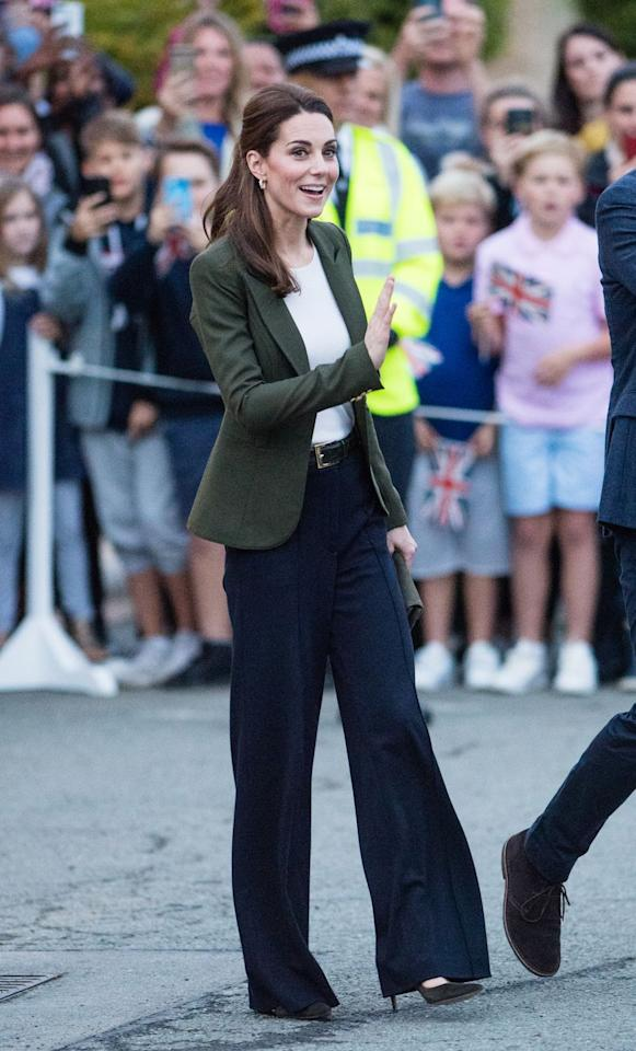 """<p>December 5, 2018 - For a visit to Cypress, the Duchess opted for chic wide-leg trousers and an olive jacket from Smythe actually called the """"<a rel=""""nofollow"""" href=""""https://shop.nordstrom.com/s/smythe-classic-duchess-blazer/4998902"""">Classic Duchess Blazer</a>."""" </p>"""