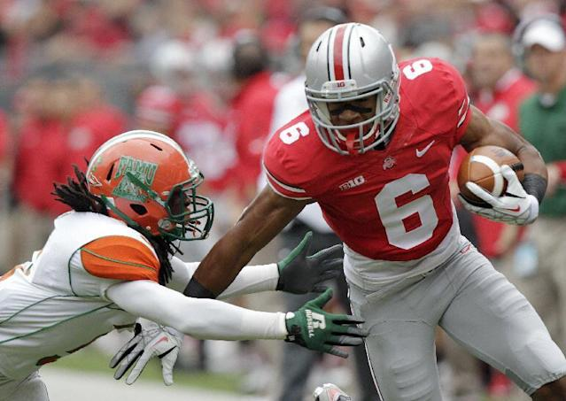 Ohio State wide receiver Evan Spencer, right, tries to escape the grasp of Florida A&M cornerback Patrick Aiken during the first quarter of an NCAA college football game Saturday, Sept. 21, 2013, in Columbus, Ohio. (AP Photo/Jay LaPrete)