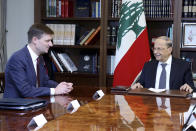 In this photo released by Lebanon's official government photographer Dalati Nohra, Lebanese President Michel Aoun, right, meets with U.S. Undersecretary of State for Political Affairs David Hale, left, at the presidential palace, in Baabda, east of Beirut, Lebanon, Monday, Oct. 21, 2019. Hale was traveling to Beirut, the most senior foreign diplomat to visit the country since the crisis. U.S. diplomats have said they support the quick formation of a government that can bring about reform. (Dalati Nohra via AP)